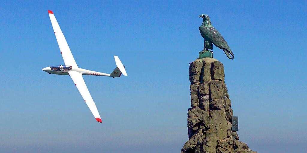 Glider pilot at the Wasserkuppe flying monument